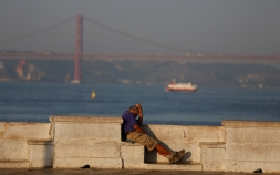 A man rests in downtown Lisbon, Portugal September 1, 2016.   REUTERS/Rafael Marchante